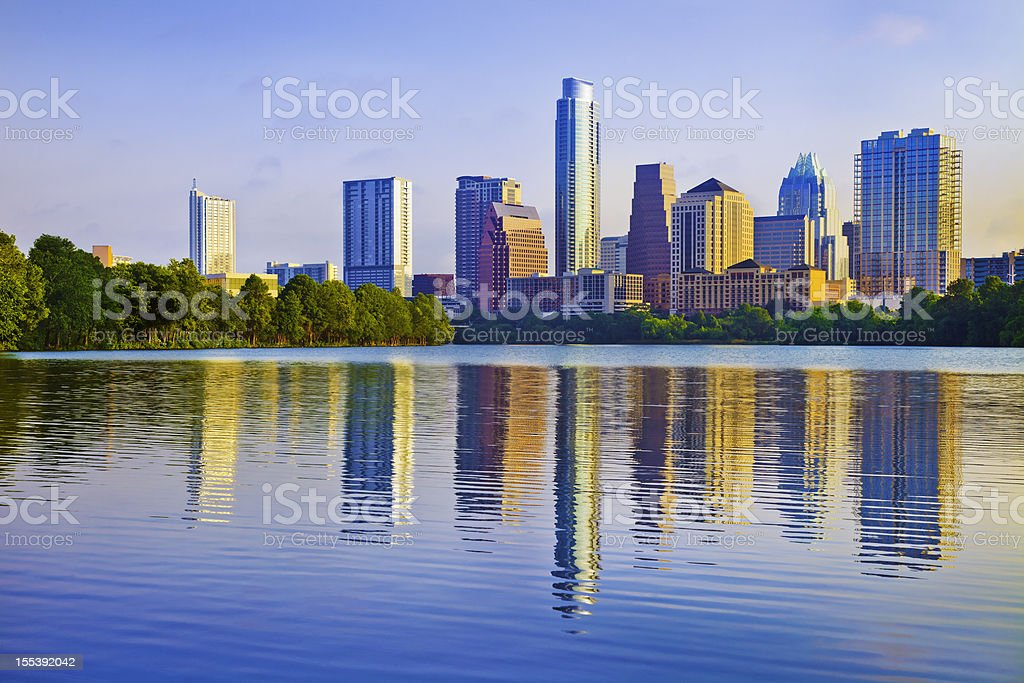 Austin skyline at sunrise reflected in Ladybird Lake royalty-free stock photo