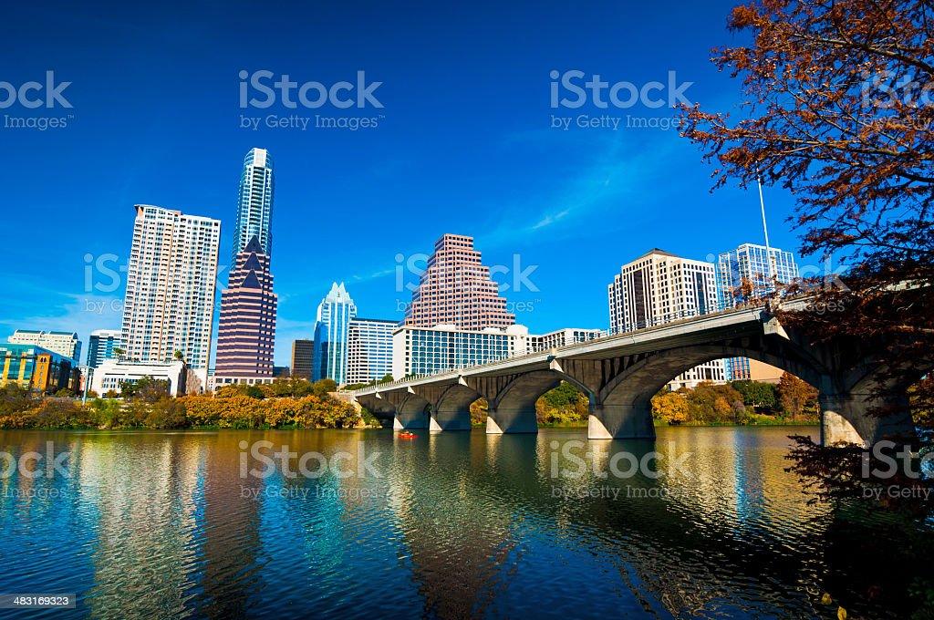 Austin skyline, bridge, lake, and fall trees stock photo