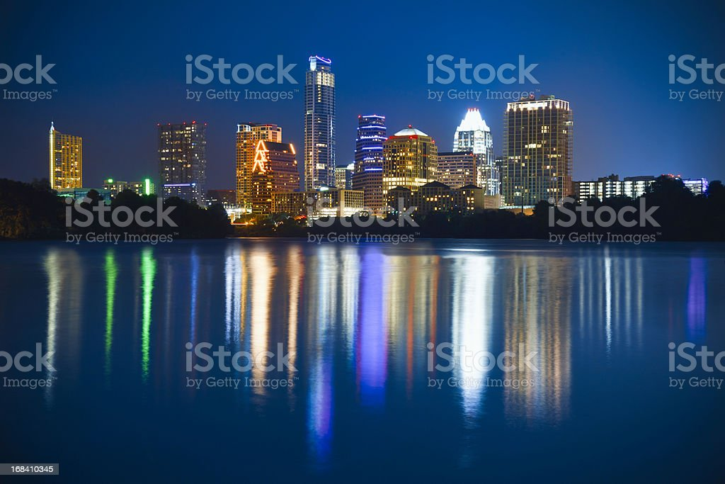 Austin skyline cityscape at night reflected in Ladybird Lake stock photo