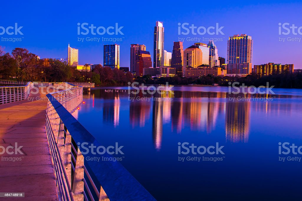 Austin Skyline Downtown Night along Lady bird Lake Pedestrian Bridge stock photo