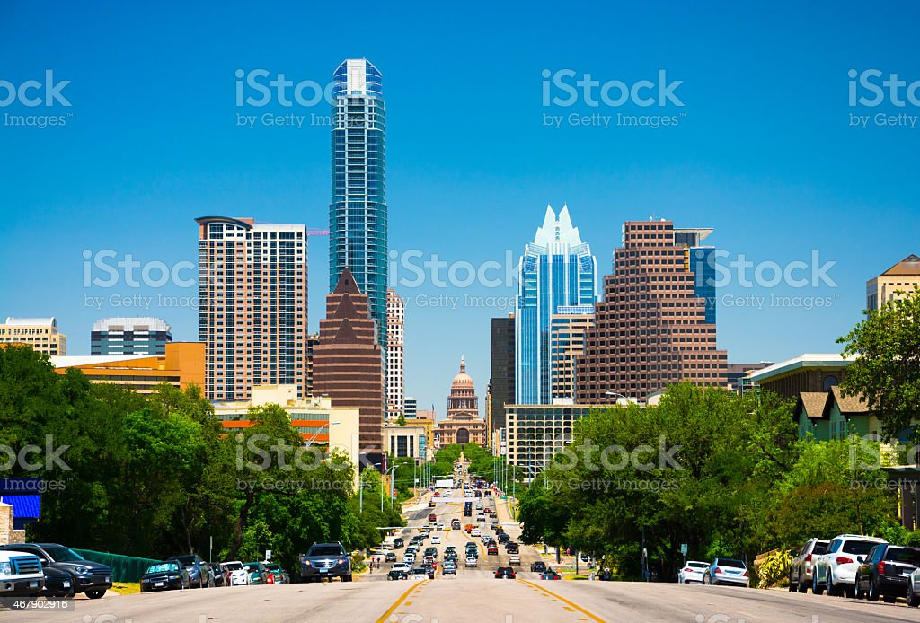 Austin skyline view with the Texas State Capitol Austin downtown skyline view and view down Congress Avenue with the Texas State Capitol building in view. 2015 Stock Photo
