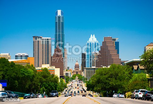 Austin downtown skyline view and view down Congress Avenue with the Texas State Capitol building in view.