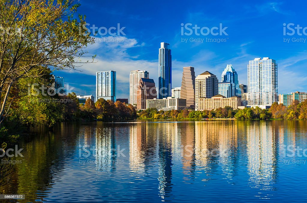 Austin Skyline with Beautiful Lake Reflections and Deep Blue Sky stock photo