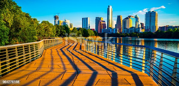 Austin Texas Abstract Skyline Cityscape as the sunrise hits the riverside pedestrian bridge modern architecture creates an amazing display of shadows across the bridge leading up to the skyline downtown