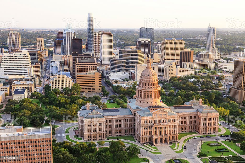Austin Texas Capitol building sunset aerial with downtown skyline background stock photo