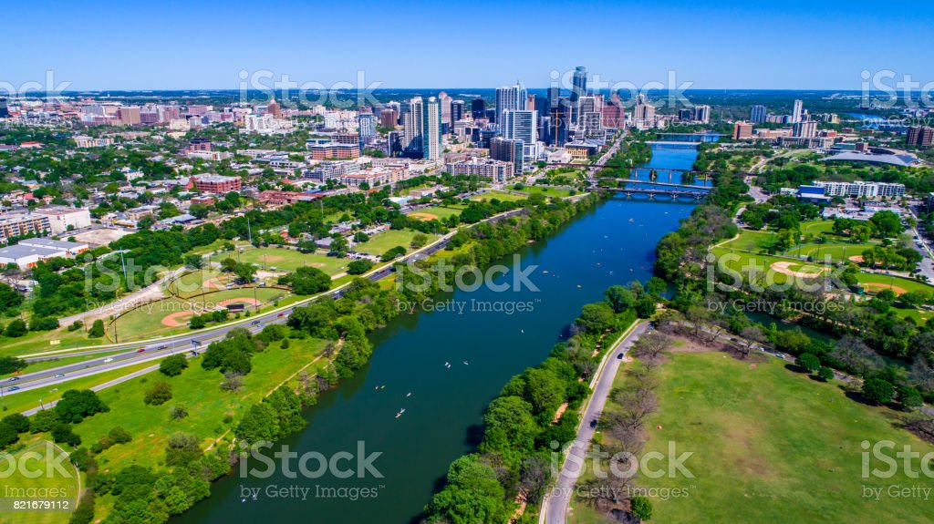 Austin Texas High Above Town Lake green parks and Downtown Cityscape in the background drone view stock photo