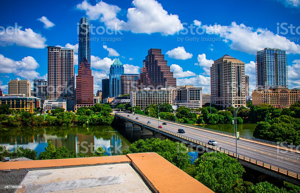 Austin Texas Skyline Cityscape Overlook Downtown Urban Lookout Austin Texas Skyline Cityscape Overlook Downtown Urban Lookout during September 2015 a brand new look at the Austin Texas Cityscape Central Texas Capital City View of the Downtown Skyline. Congress Avenue heading towards the capital with the Frost Bank tower and the office buildings and towers all in a line. Austin skyline, Town Lake and Congress Avenue Bridge; Austin,Texas (TX). This barrel-arched bridge with its open spandrel construction, built in 1910, is an Austin landmark. 2015 Stock Photo
