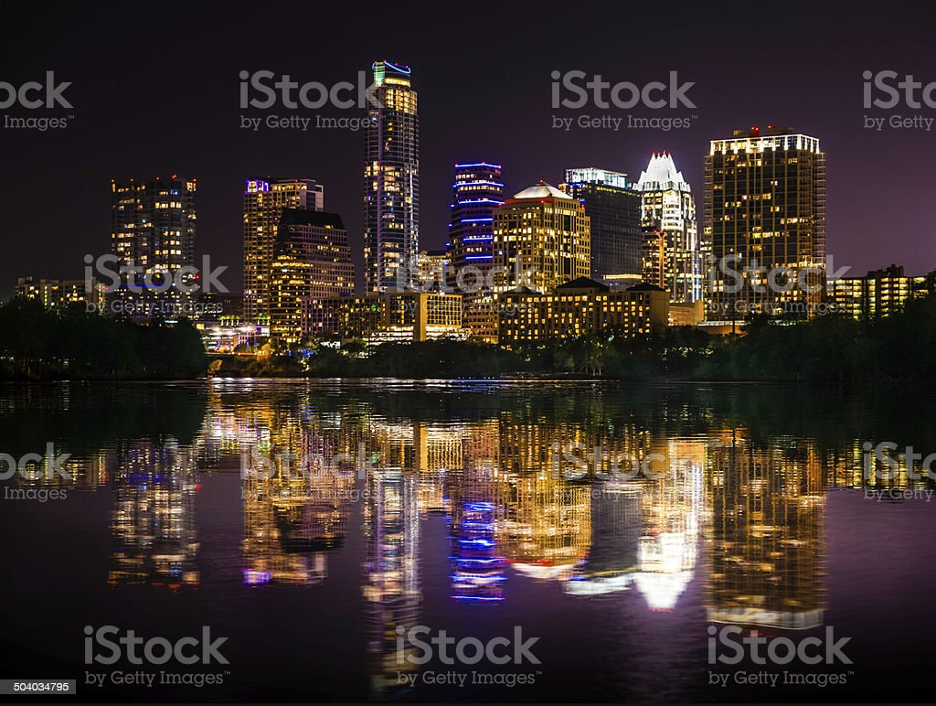 Austin Texas skyline cityscape reflection over Ladybird Lake at night stock photo