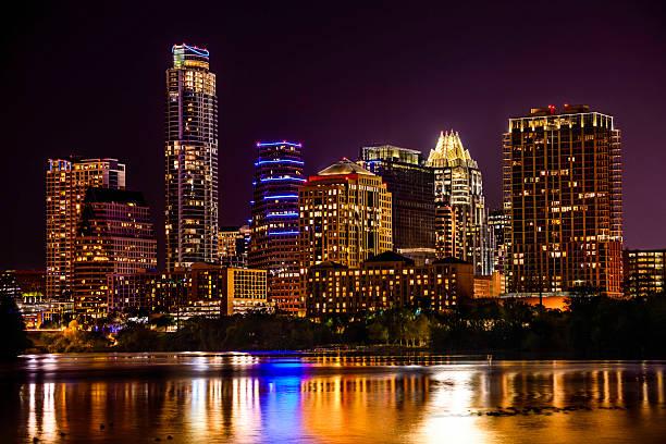 Austin, Texas skyline cityscape skyscrapers over Ladybird Lake at night stock photo