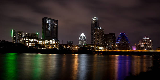 Austin Texas Skyline Reflecting in River at Night stock photo