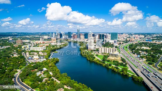 Austin Texas Puffy Clouds on a Summer Day blue sky and gorgeous water over Town Lake Skyline Cityscape summertime