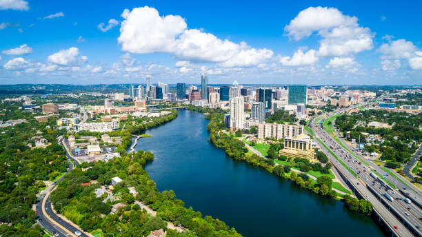 Austin Texas summertime Austin Texas Puffy Clouds on a Summer Day blue sky and gorgeous water over Town Lake Skyline Cityscape summertime colorado river stock pictures, royalty-free photos & images