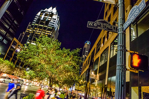Austin TX downtown night life, 6th congress street sign intersection stock photo