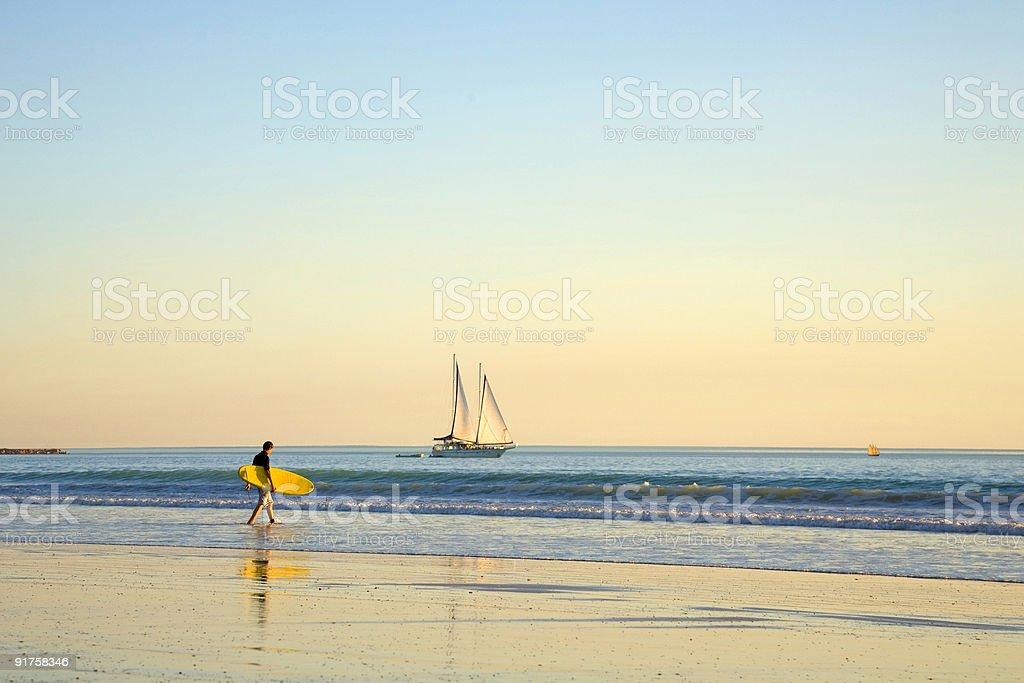 Australia Broome Cable Beach Surfer and Sailing Ship stock photo