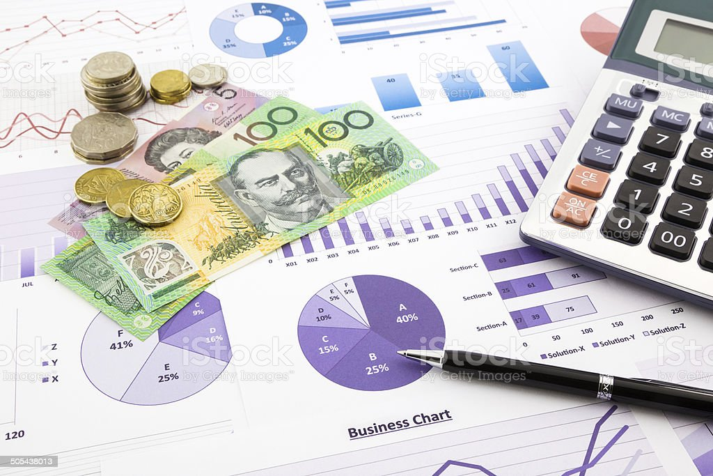 Australia currency on financial graphs report stock photo
