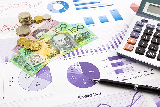 Australia currency on financial graphs report australia dollar currency on financial charts, expense cash flow summarizing and graphs background, concepts for saving money, budget management, stock exchange, investment and business income report cash flow stock pictures, royalty-free photos & images