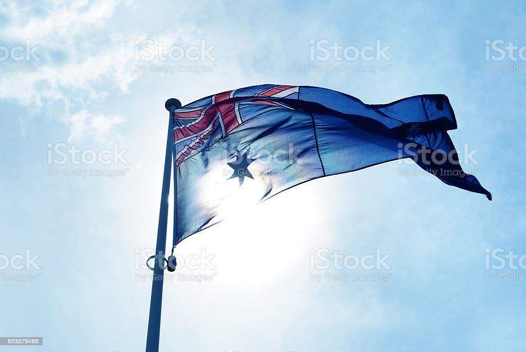 Australia flag waving in blue sky stock photo