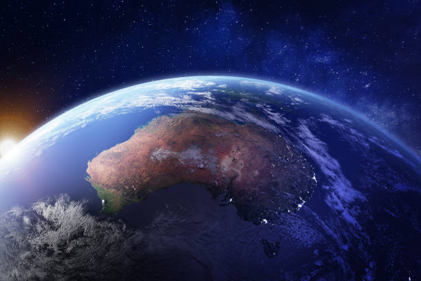 Australia from space at night with city lights of Sydney, Melbourne and Brisbane, view of Oceania, Australian desert, communication technology, 3d render of planet Earth, elements from NASA Australia from space at night with city lights of Sydney, Melbourne and Brisbane, view of Oceania, Australian desert, communication technology, 3d render of planet Earth, elements from NASA (https://eoimages.gsfc.nasa.gov/images/imagerecords/57000/57752/land_shallow_topo_21600.tif) australia stock pictures, royalty-free photos & images