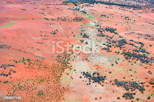 Australia, NT, aerial view of an outback track through arid landscape