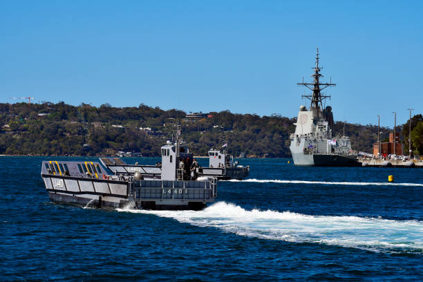 Australia, Sydney, warships in navy base Sydney, NSW, Australia - October 31, 2017: Warship HMAS Hobart in Wooloomooloo wharf and exercise with landing crafts of the Royal Australian navy naval base stock pictures, royalty-free photos & images