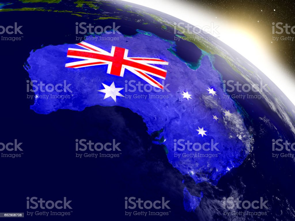 Australia with flag in rising sun stock photo