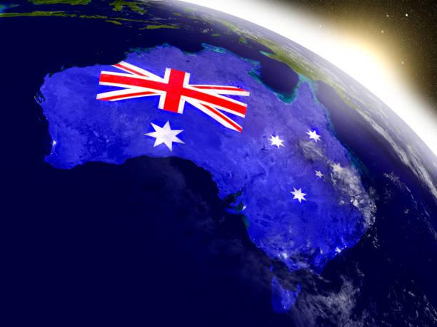 Australia with flag in rising sun stock photo