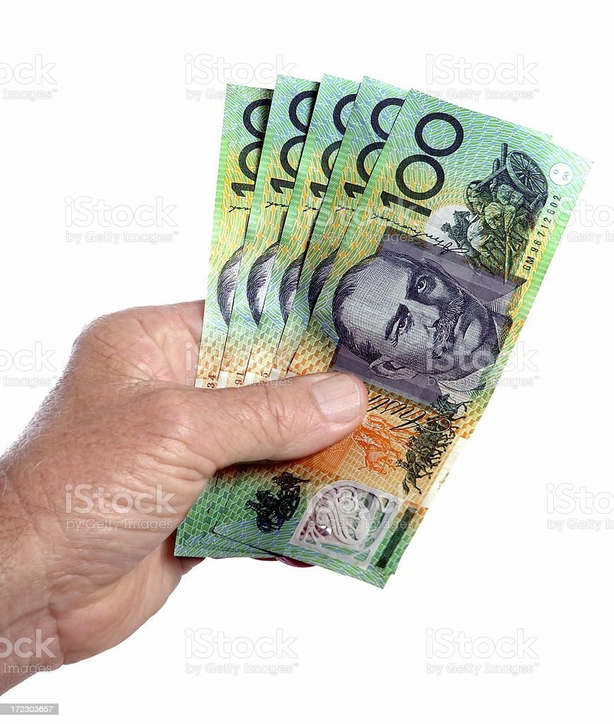 Australian 100 dollar notes cash in the hand white background royalty-free stock photo