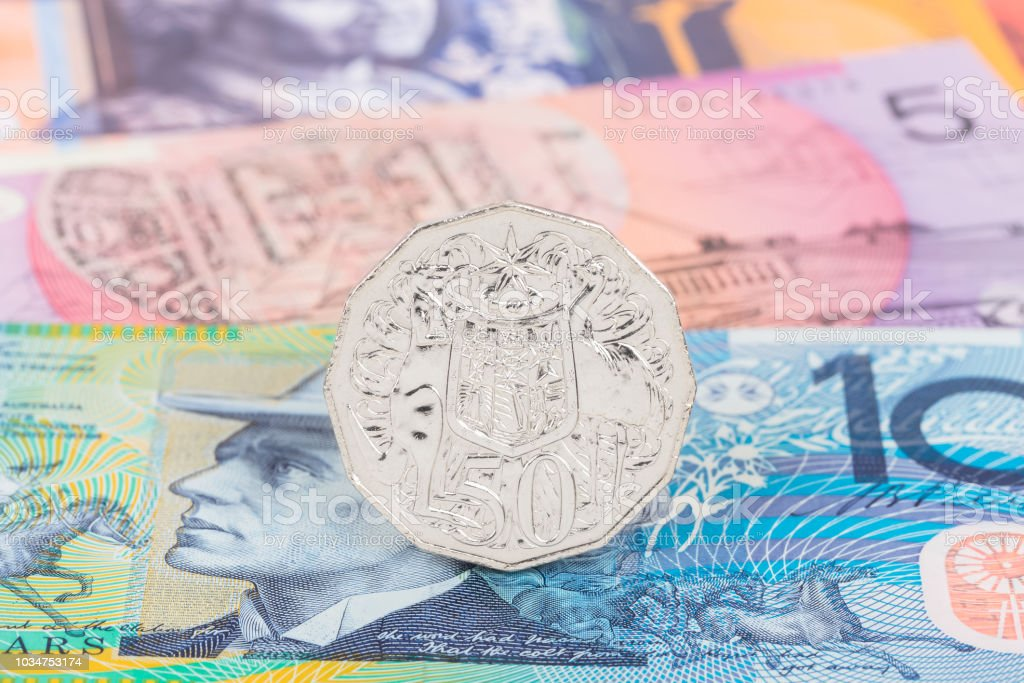 Australian 50 cent coin stand on dollar banknote money stock photo