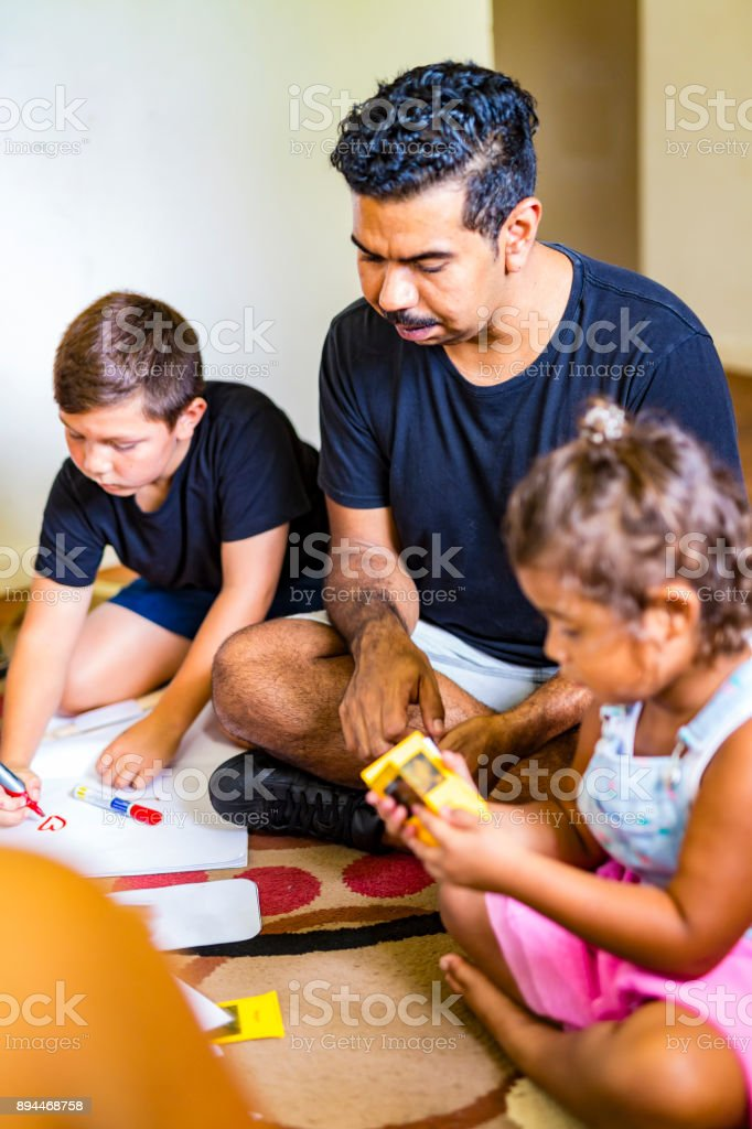Australian Aboriginal Family Group Playing a Game stock photo