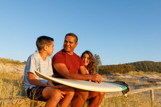 Australian Aboriginal Father and Children stock photo
