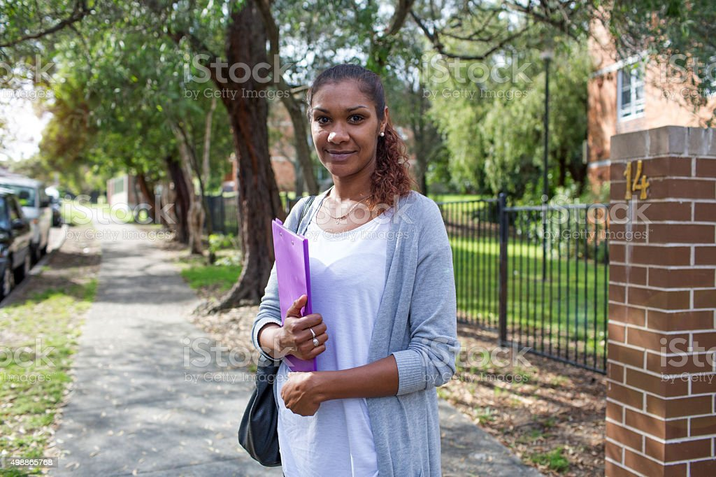 Australian Aboriginal indigenous woman university student stock photo