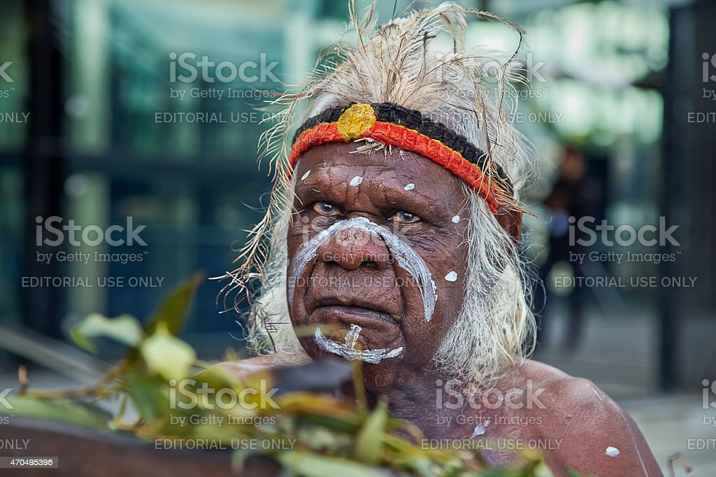 Australian aborigine performs a smoking ceremony stock photo