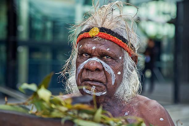 Australian aborigine performs a smoking ceremony stock photo