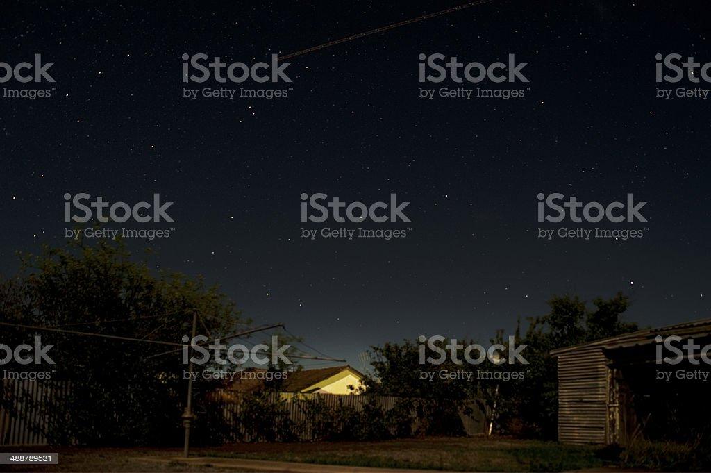 Australian backyard at night stock photo