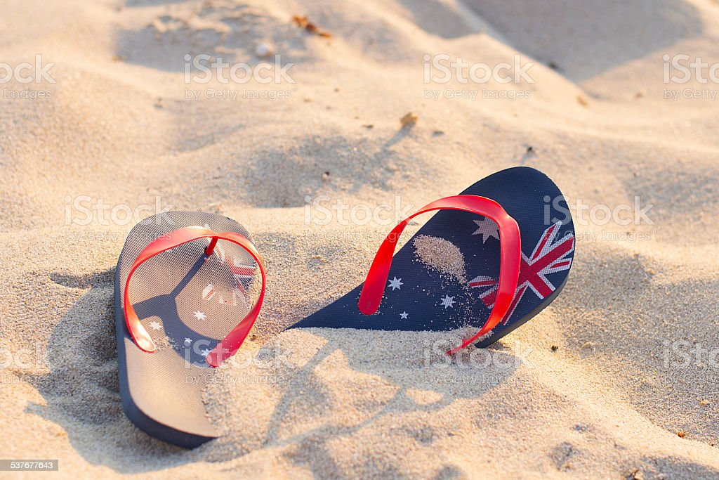 Australian beach with thongs stuck in the sand stock photo