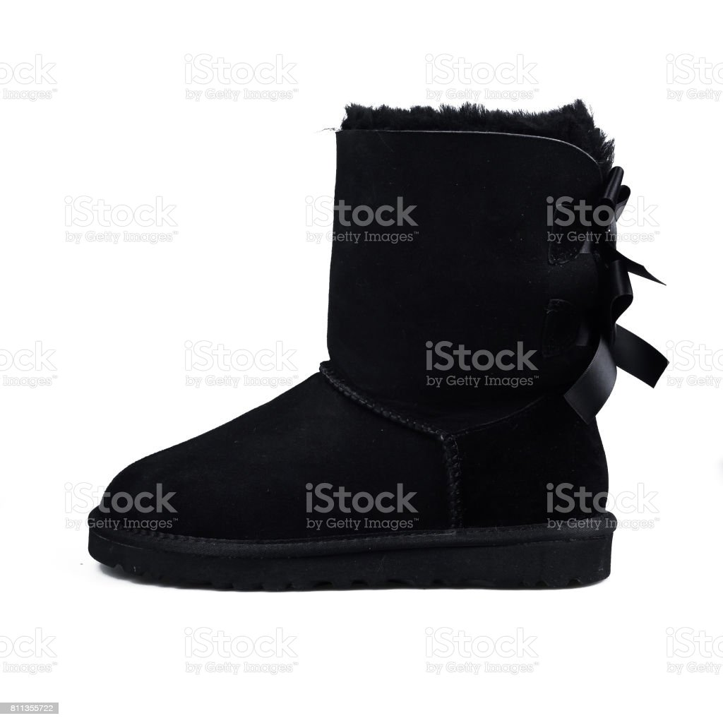 52bb9def42f5 Australian black Trendy winter shoes. Fur women s boots on white background  - Stock image .