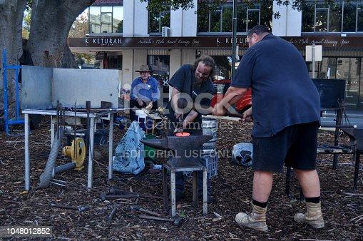 istock Australian blacksmith people working hit the iron for show 1048012852