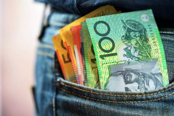 Australian cash in mans jeans pocket stock photo