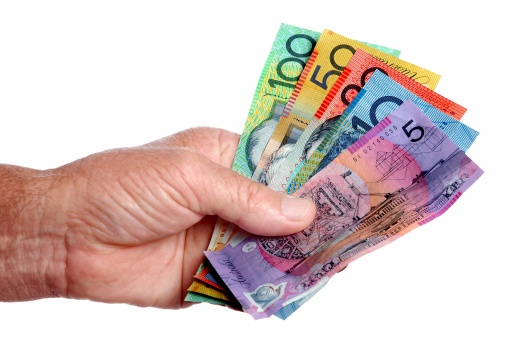 Australian dollar notes held in the hand. Click to see more...