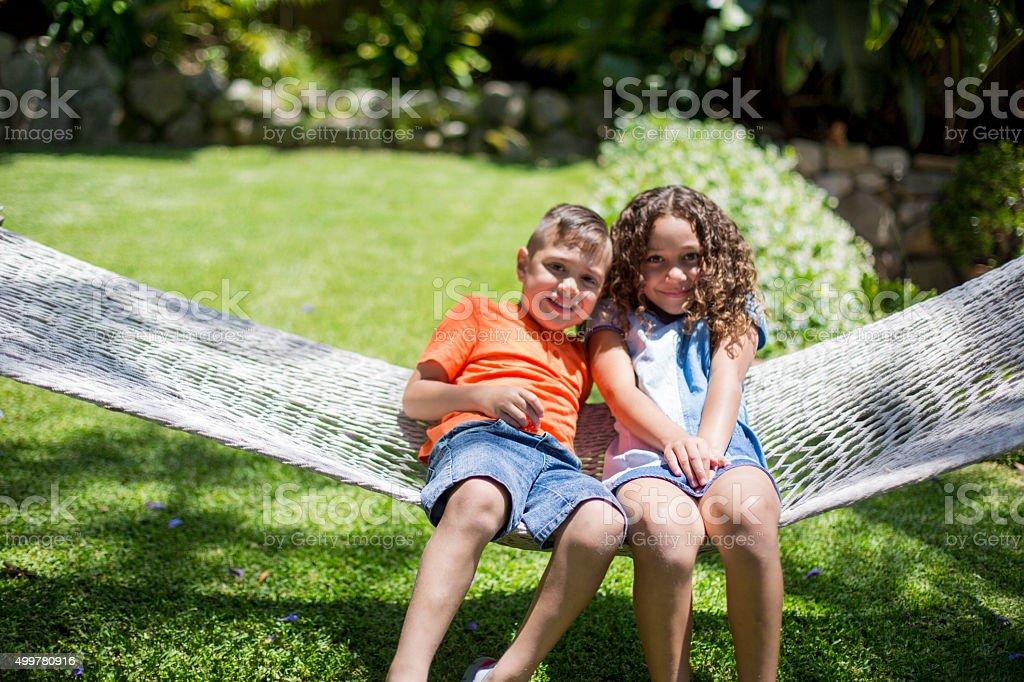Australian children playing in hammock stock photo