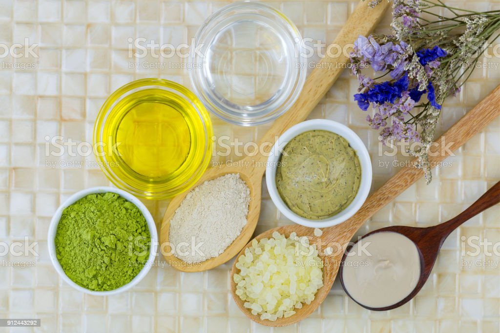 Australian Clay Powder, Coconut oil, Jojoba Golden Oil, Ground green tea, Matcha Green tea scrub to make home spa beauty skin product stock photo