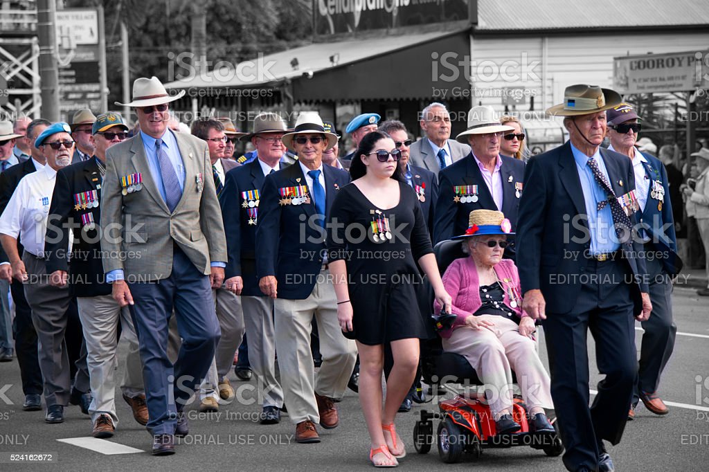 Australian Defence Force veterans march through Cooroy on ANZAC Day stock photo