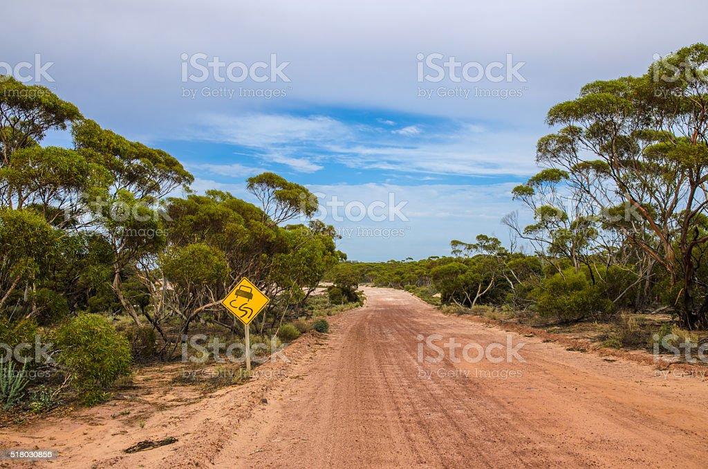 australian trees australian dirt road outback eucalyptus trees warning sign stock