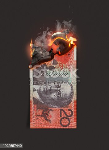 A concept image showing a half burnt flat Australian dollar paper note still on fire on a dark studio background - 3D render