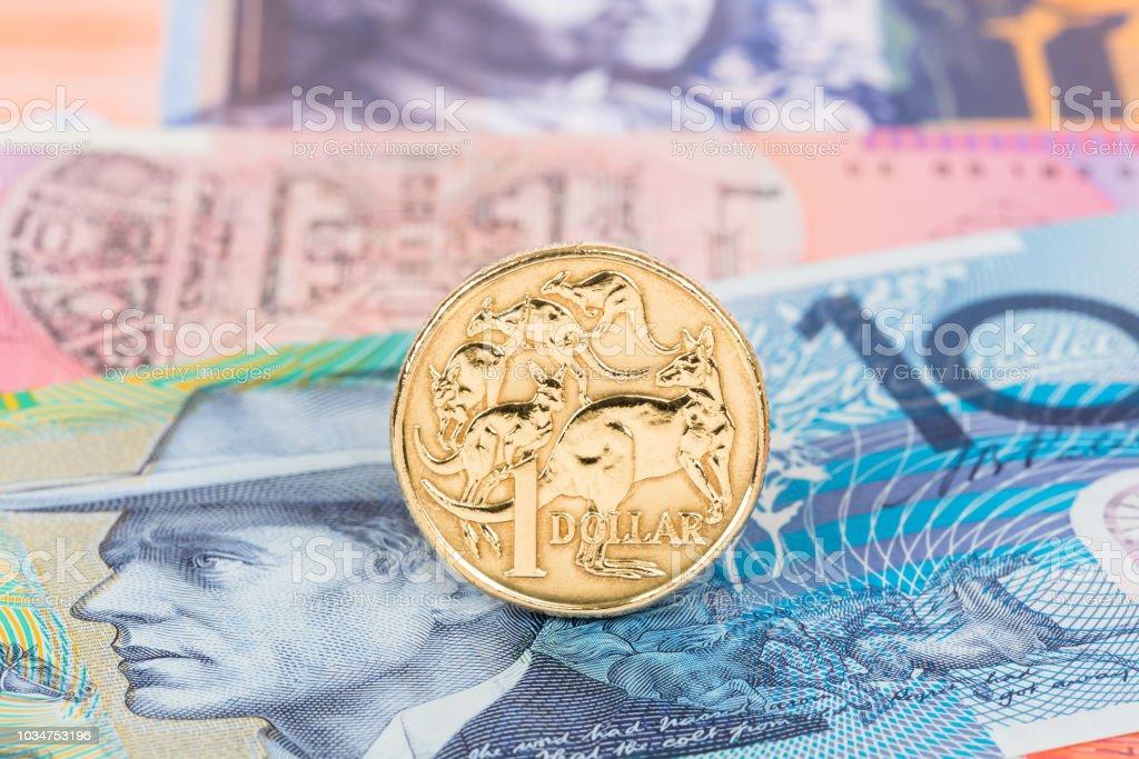Australian dollar coin stand on banknote money stock photo