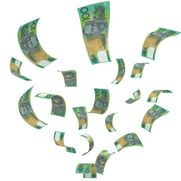 Australian dollar falling money stock photo