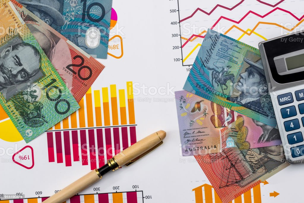Australian dollar on business graph with calculator and pen stock photo