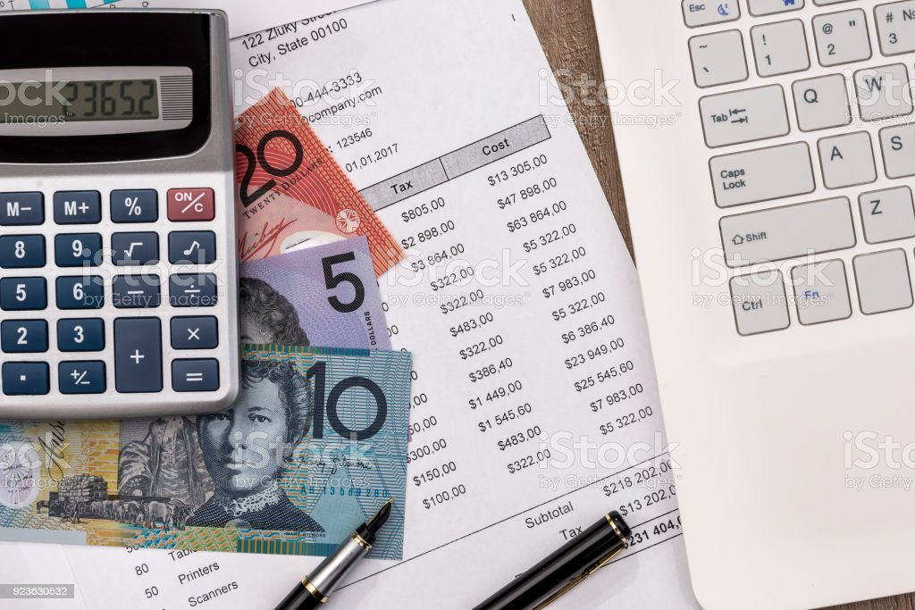 australian dollar with graph, home budget laptop and calculator stock photo