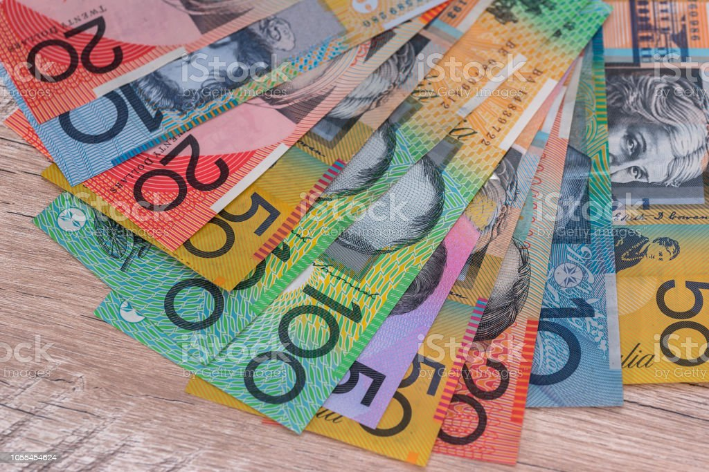 Australian dollars in fan on wooden desk stock photo