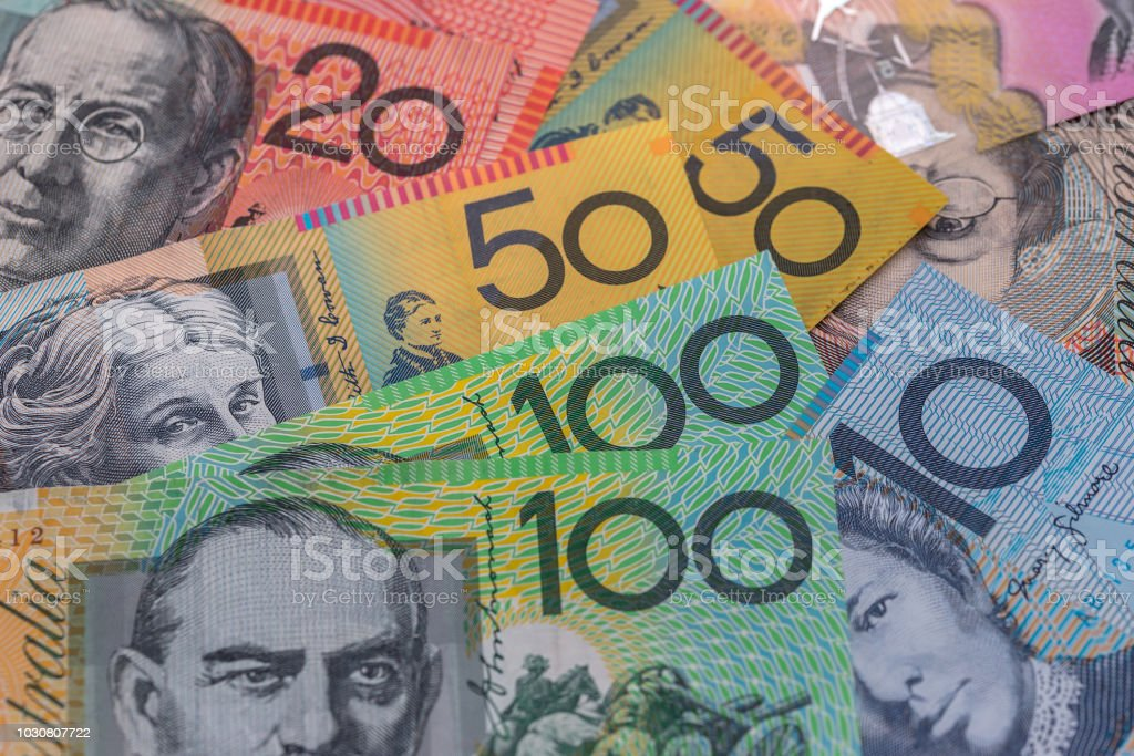 Australian dollars in rows used as background stock photo